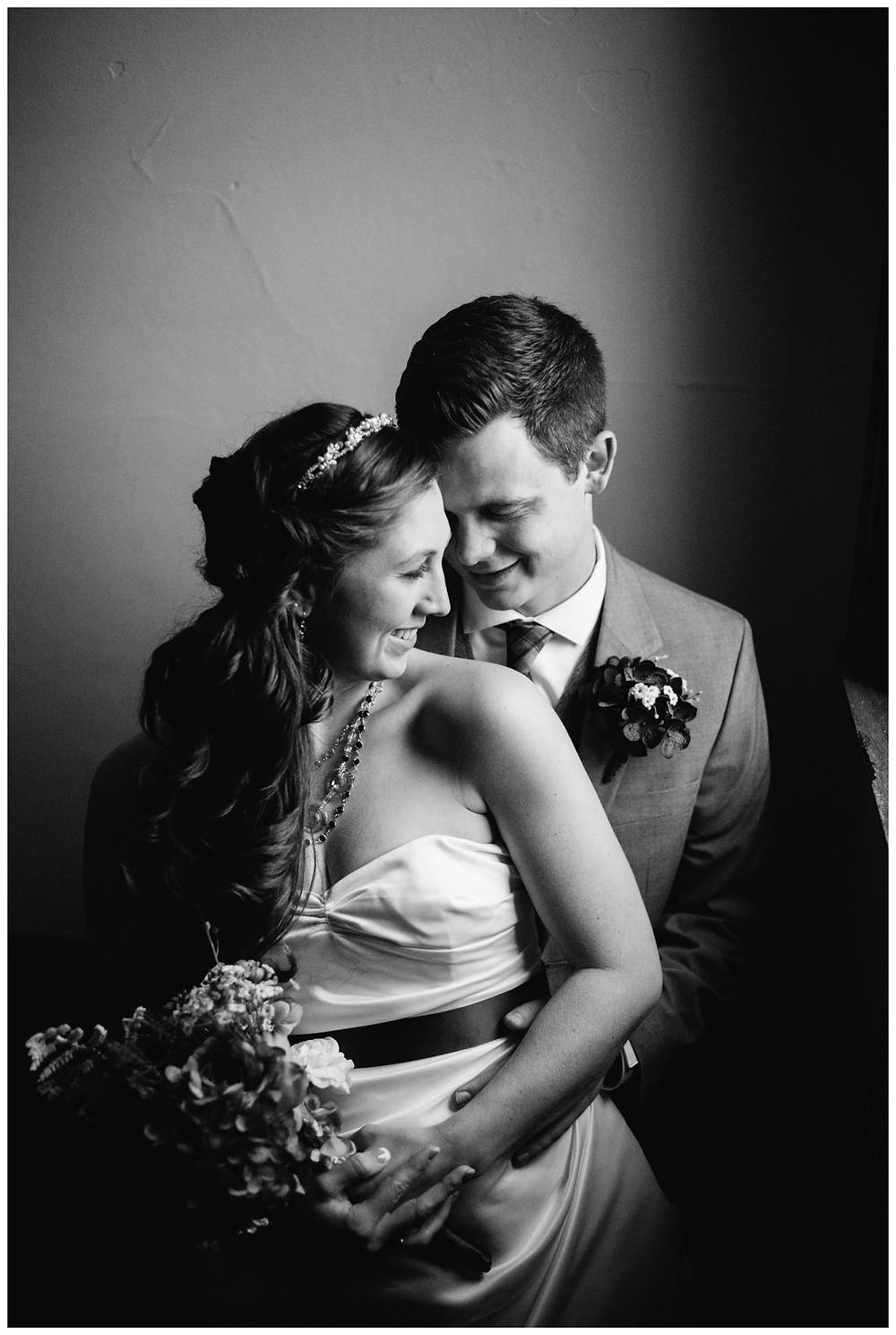 groom-holds-bride-at-milwaukee-wedding-by-green-bay-wedding-photographer-kyra-rane-photographer