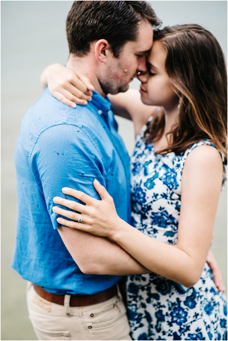 engaged-couple-foreheads-together-at-cave-point-engagement-session-by-appleton-wedding-photographer-kyra-rane-photography