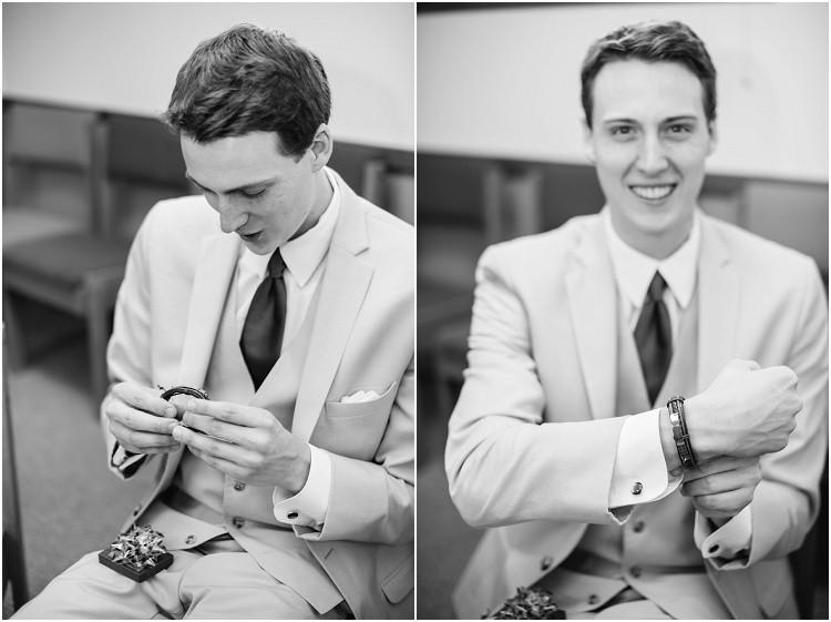 groom-opening-gift-from-bride-at-minnesota-wedding-by-appleton-wedding-photographer-kyra-rane-photography
