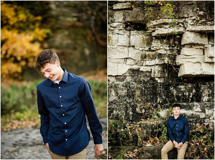 boy-sitting-against-rocks-camera-at-senior-session-at-high-cliff-state-park-by-appleton-wedding-photographer-kyra-rane-photography