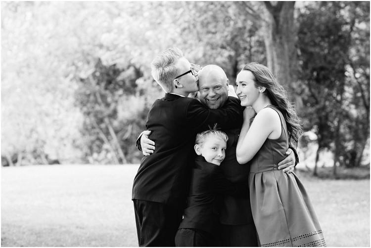 kids-hugging-dad-at-wisconsin-farm-wedding-by-appleton-wedding-photographer-kyra-rane-photography