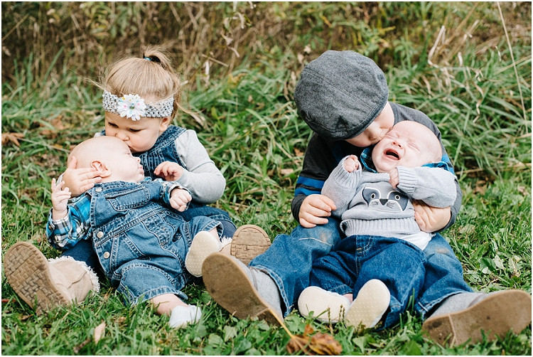 older-siblings-kissing-twin-brothers-at-fall-mini-session-favorites-by-green-bay-wedding-photographer-kyra-rane-photography