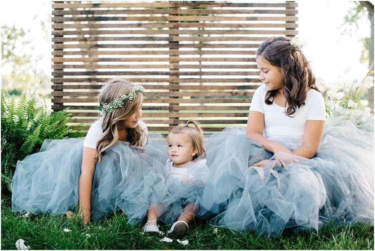 sisters-sitting-at-little-chute-waterfront-wedding-by-green-bay-wedding-photographer-kyra-rane-photography
