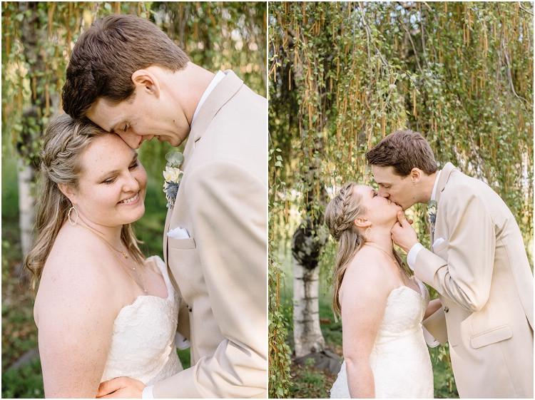 groom-kissing-bride-under-willow-tree-at-minnesota-wedding-by-green-bay-wedding-photographer-kyra-rane-photography