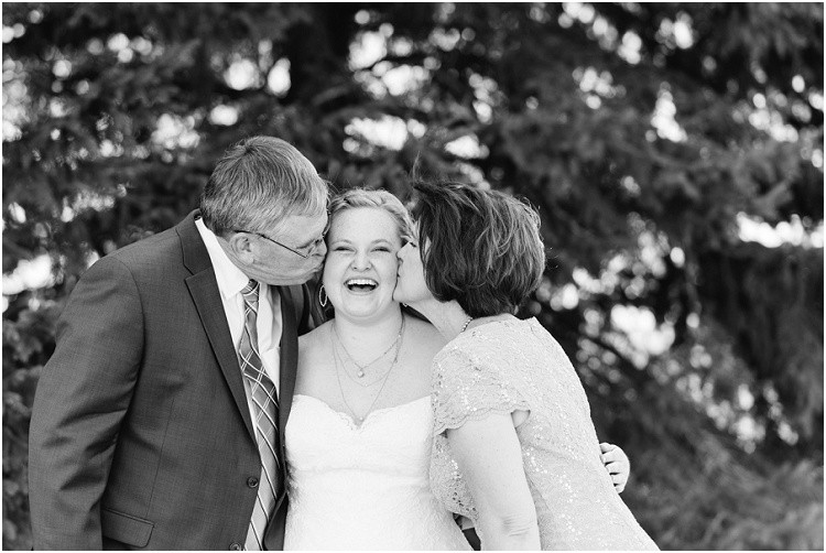 bride-being-kissed-on-cheek-by-mom-and-dad-at-minnesota-wedding-by-milwaukee-wedding-photographer-kyra-rane-photography