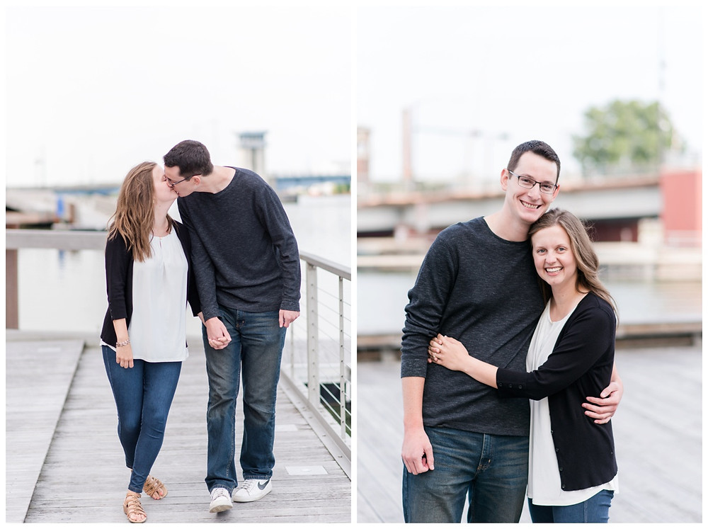 engaged-couple-smiling-at-camera-at-downtown-green-bay-engagement-session-by-green-bay-wedding-photographer-kyra-rane-photography