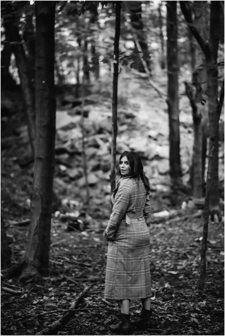 woman-looking-back-walking-by-trees-at-folklore-inspired-shoot-by-appleton-wedding-photographer-kyra-rane-photography