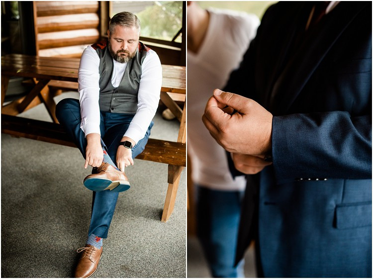 groom-putting-on-shoes-at-northern-wisconsin-autumn-wedding-by-green-bay-wedding-photographer-kyra-rane-photography