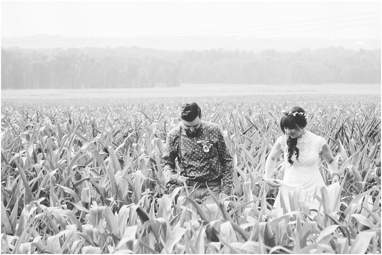 bride-and-groom-walking-through-corn-field-at-july-4th-elopement-by-green-bay-wedding-photographer-kyra-rane-photography