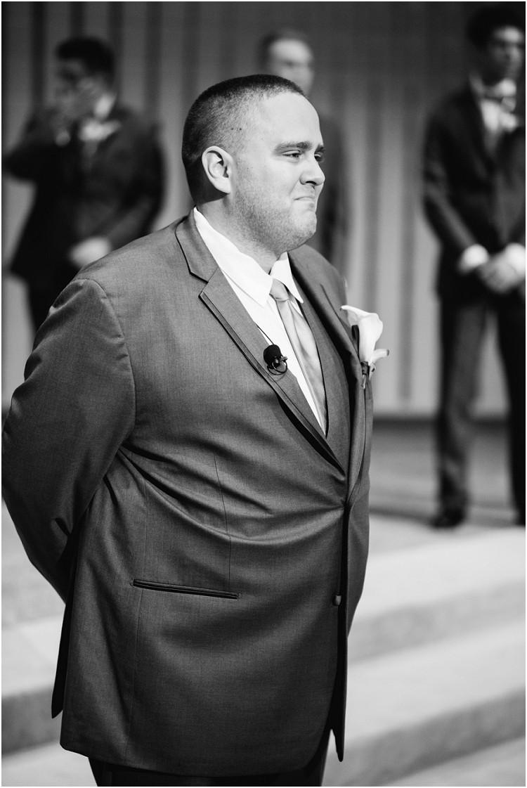 groom-watching-bride-walk-down-aisle-at-olde-41-wedding-by-appleton-wedding-photographer-kyra-rane-photography