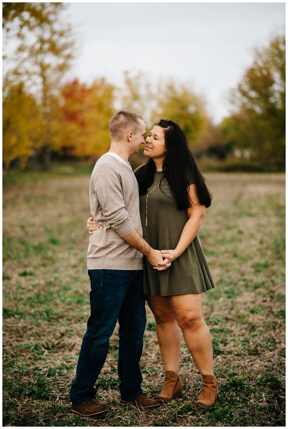 engaged-couple-about-to-kiss-holding-hands-at-green-bay-engagement-session-by-appleton-wedding-photographer-kyra-rane-photography