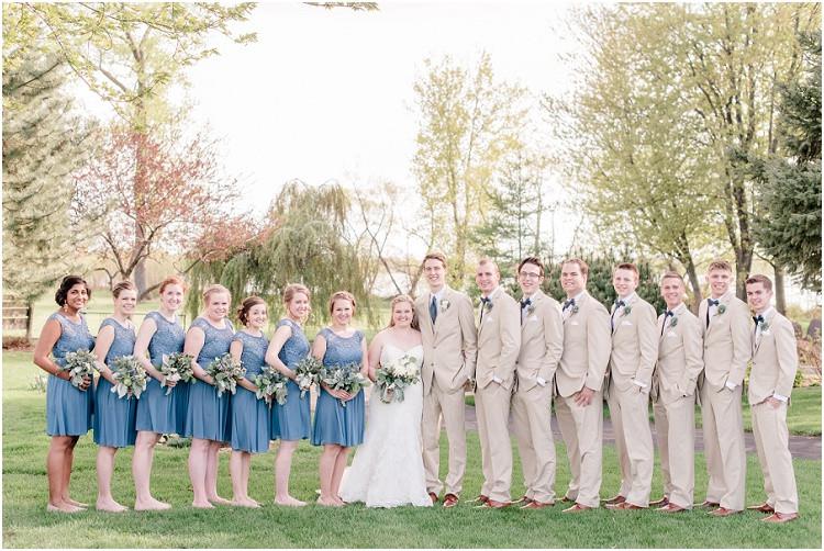 wedding-party-smiling-at-camera-at-minnesota-wedding-by-appleton-wedding-photographer-kyra-rane-photography