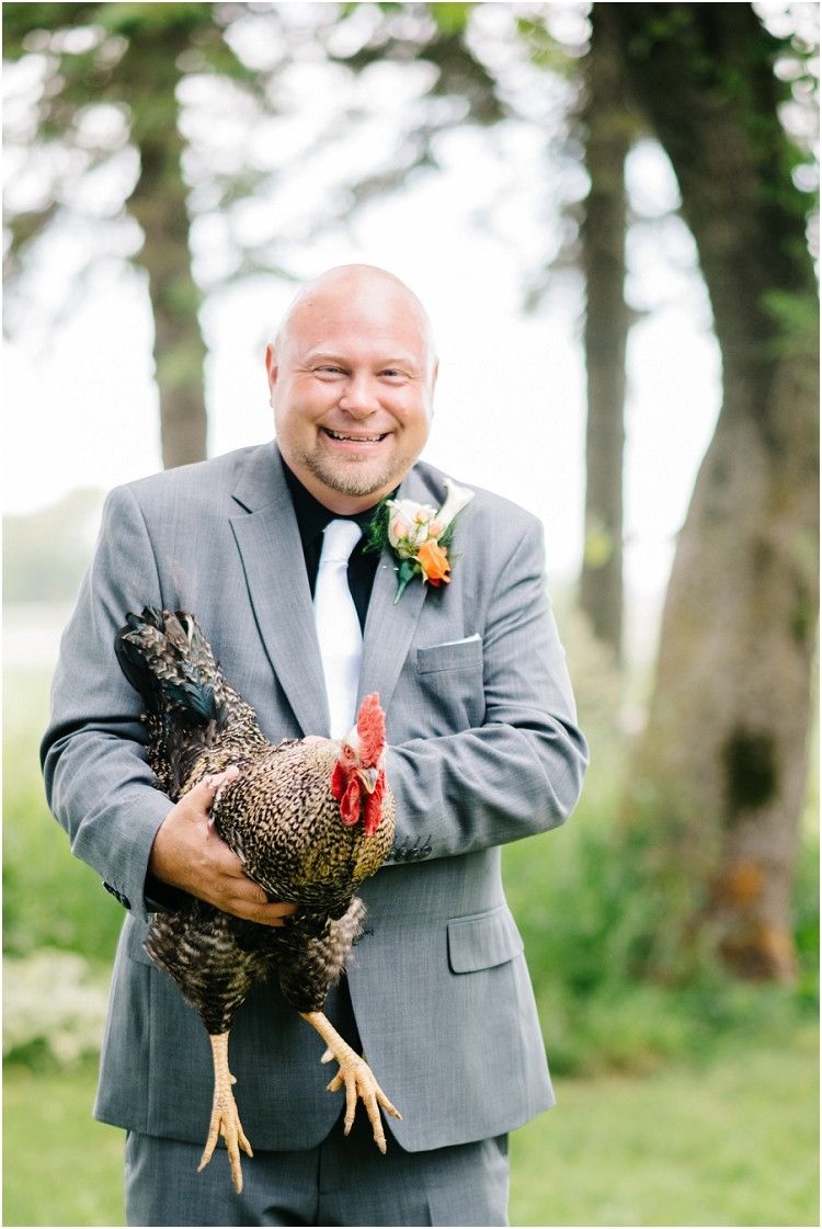 groom-holding-chicken-at-wisconsin-farm-wedding-by-green-bay-wedding-photographer-kyra-rane-photography