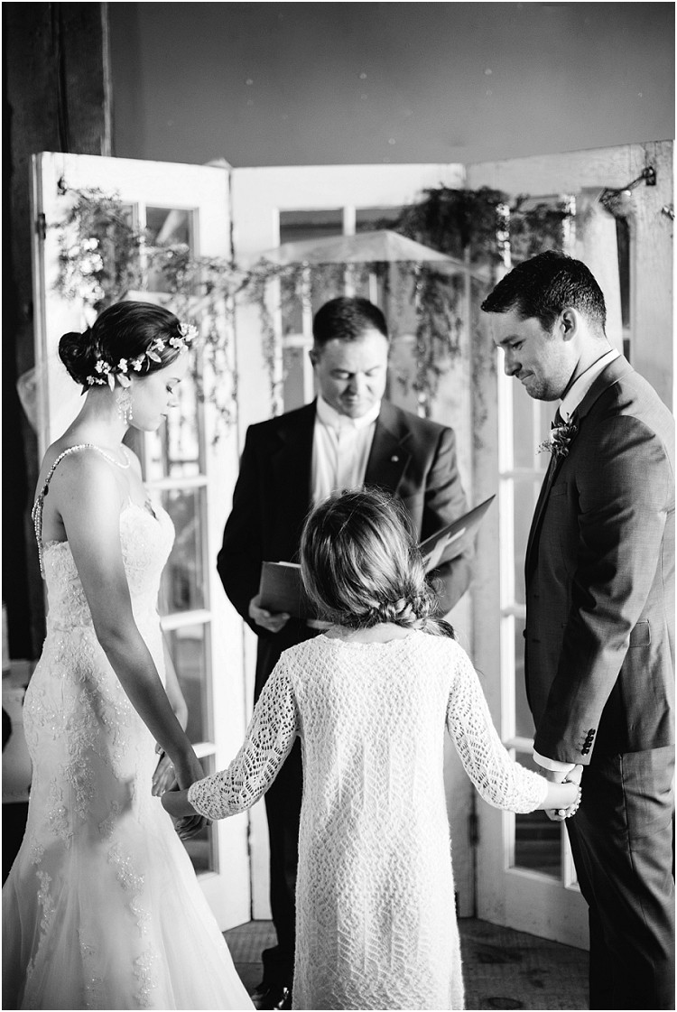 wedding-couple-praying-with-daughter-at-barnsite-retreat-and-events-wedding-by-milwaukee-wedding-photographer-kyra-rane-photography