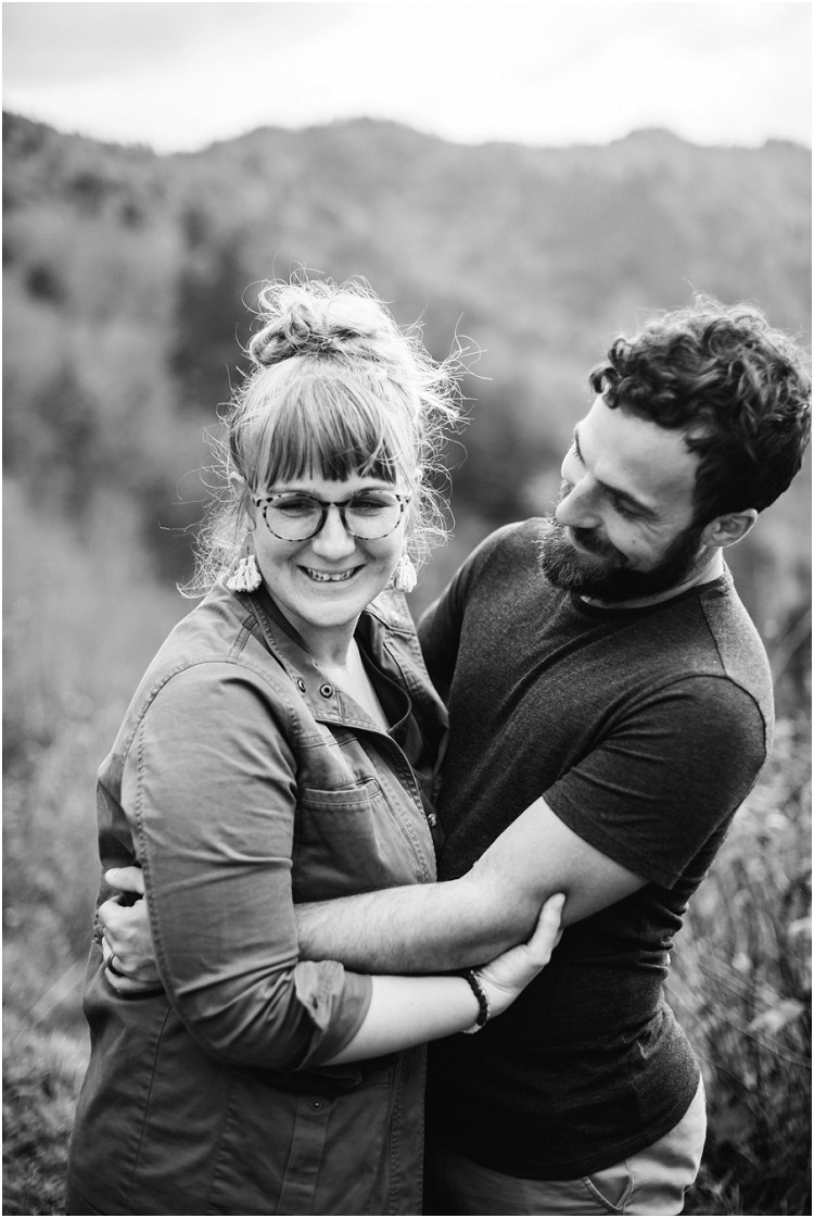 husband-and-wife-holding-each-other-and-husband-looking-at-wife-at-family-session-in-the-great-smoky-mountains-by-milwaukee-wedding-photographer-kyra-rane-photography