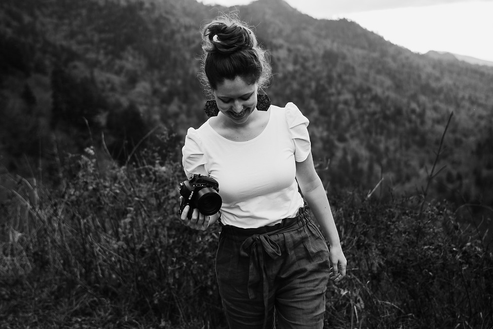 girl-holding-camera-on-mountain-at-start-a-photography-business-by-appleton-wedding-photographer-kyra-rane-photography
