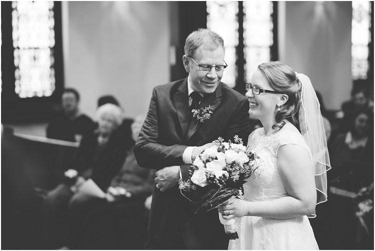 father-of-bride-giving-daughter-away-at-sheboygan-winter-wedding-by-appleton-wedding-photographer-kyra-rane-photography