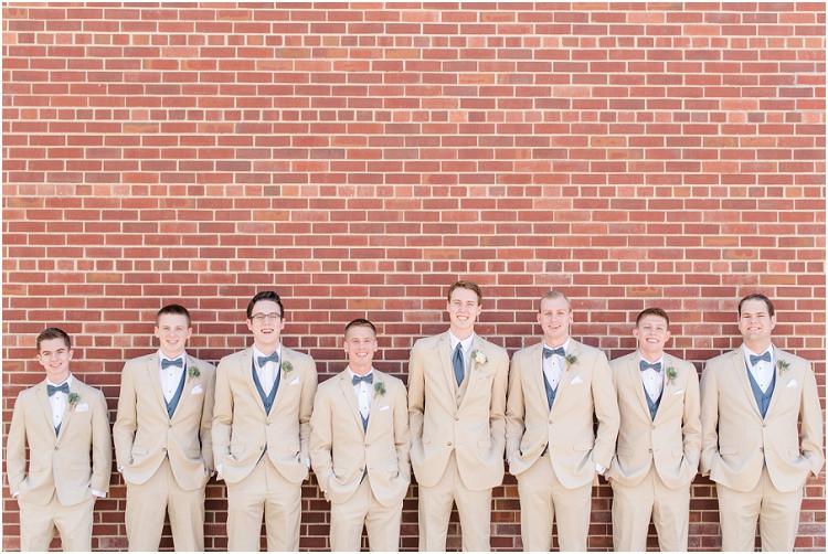 groom-and-groomsmen-smiling-at-camera-at-minnesota-wedding-by-milwaukee-wedding-photographer-kyra-rane-photography