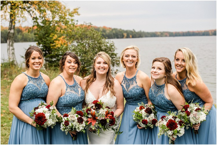 bridesmaids-looking-at-camera-at-northern-wisconsin-autumn-wedding-by-milwaukee-wedding-photographer-kyra-rane-photography