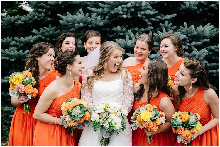 bride-and-bridesmaids-excited-at-pamperin-park-wedding-by-green-bay-wedding-photographer-kyra-rane-photography