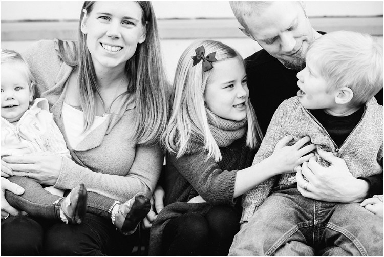 family-sitting-on-front-steps-together-at-front-porch-family-session-by-green-bay-wedding-photographer-kyra-rane-photography