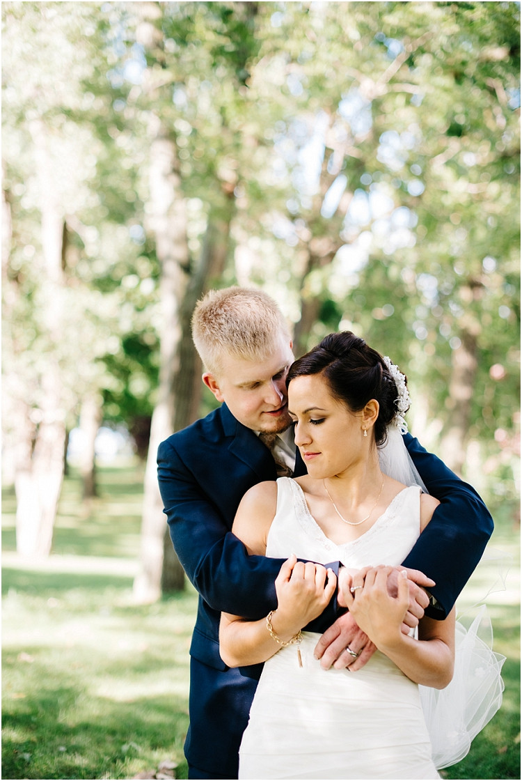 bride-and-groom-holding-each-other-at-de-pere-wedding-by-appleton-wedding-photographer-kyra-rane-photography
