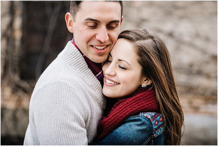 engaged-couple-holding-each-other-close-at-appleton-engagement-session-by-milwaukee-wedding-photographer-kyra-rane-photography