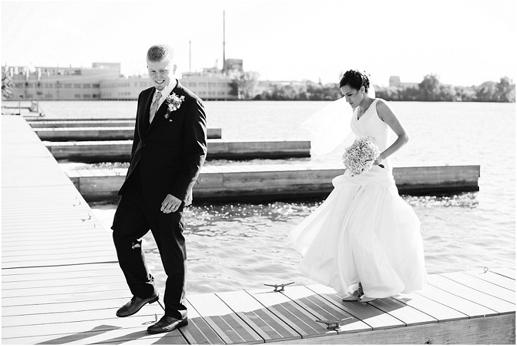 wedding-couple-walking-on-dock-at-de-pere-wedding-by-appleton-wedding-photographer-kyra-rane-photography