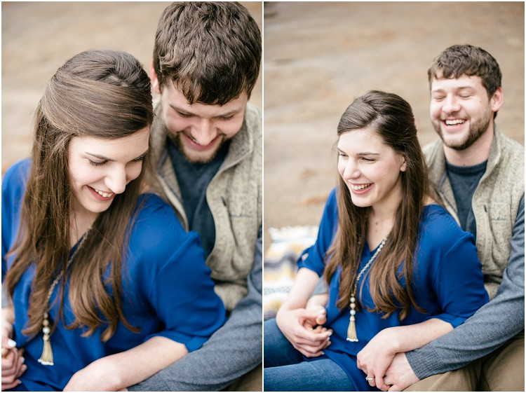 engaged-couple-sitting-in-lap-laughing-at-northwoods-lakeside-engagement-session-by-appleton-wedding-photographer-kyra-rane-photography