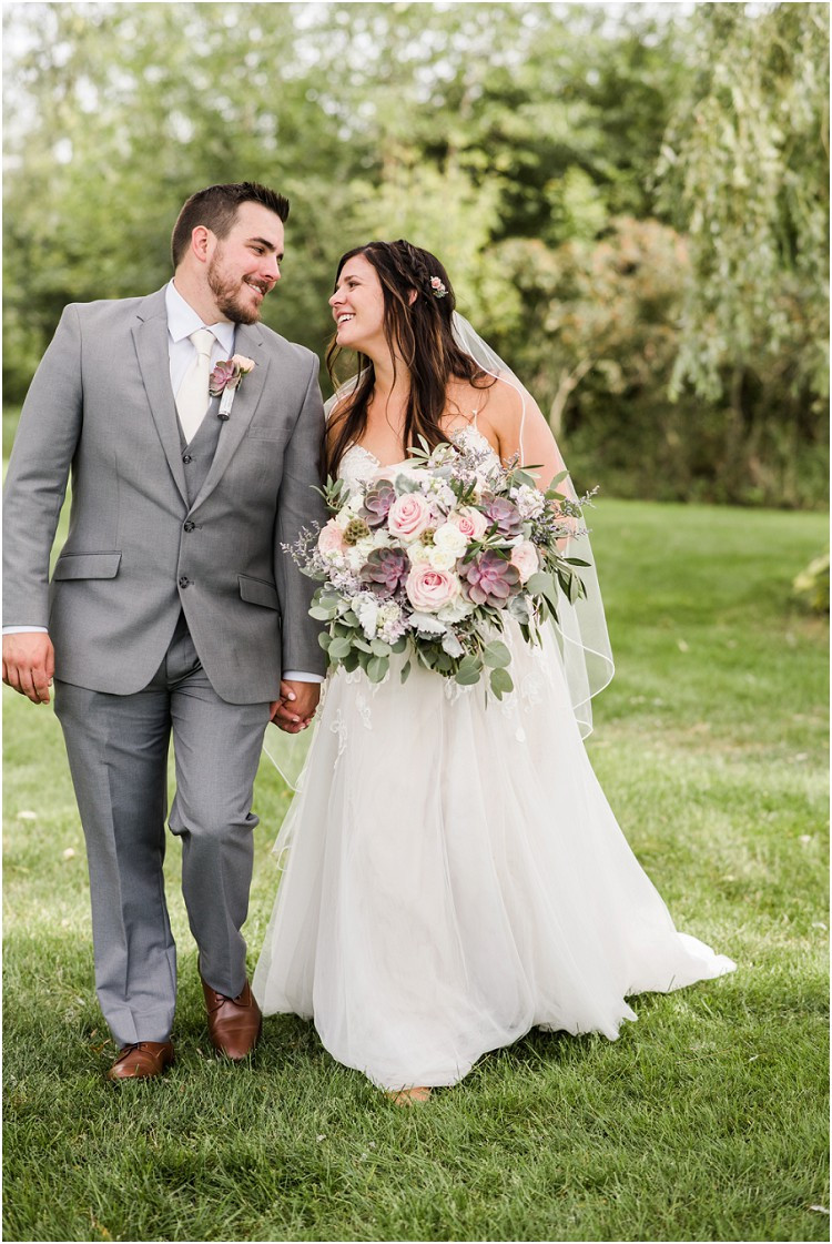 bride-and-groom-walking-and-smiling-at-de-pere-wisconsin-wedding-by-appleton-wedding-photographer-kyra-rane-photography