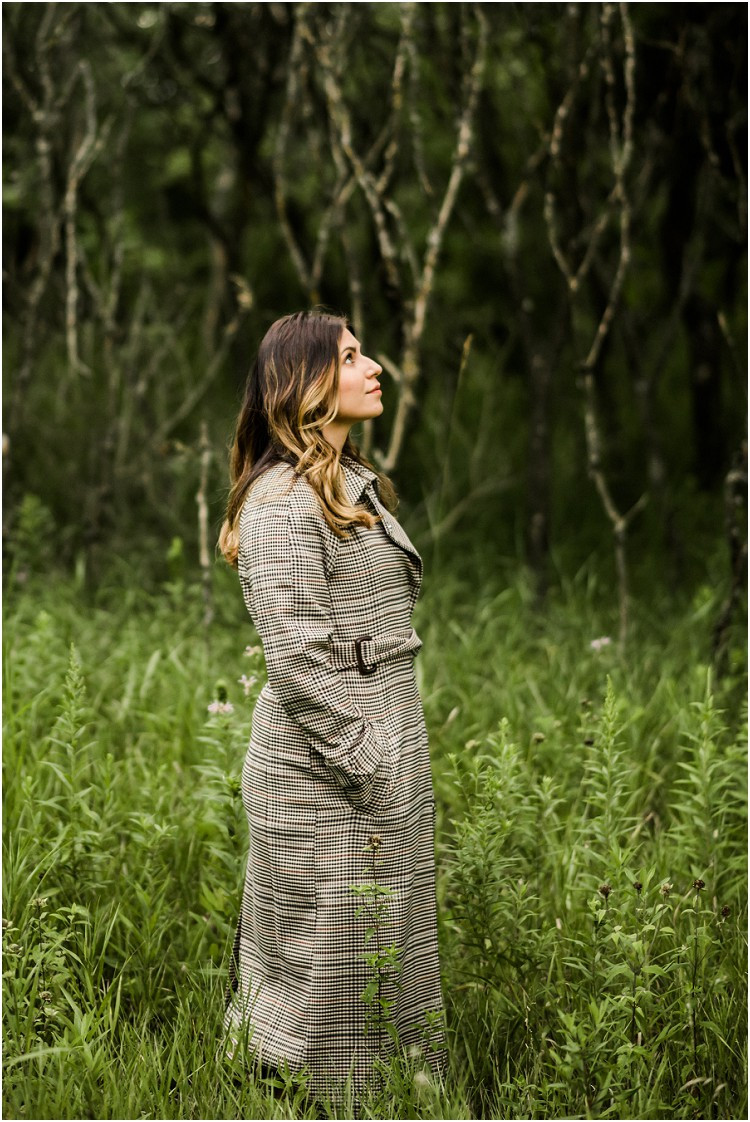 woman-looking-up-in-field-at-folklore-inspired-shoot-by-green-bay-wedding-photographer-kyra-rane-photography