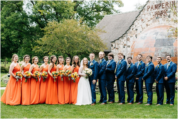 bride-and-groom-with-wedding-party-smiling-at-camera-at-pamperin-park-wedding-by-appleton-wedding-photographer-kyra-rane-photography