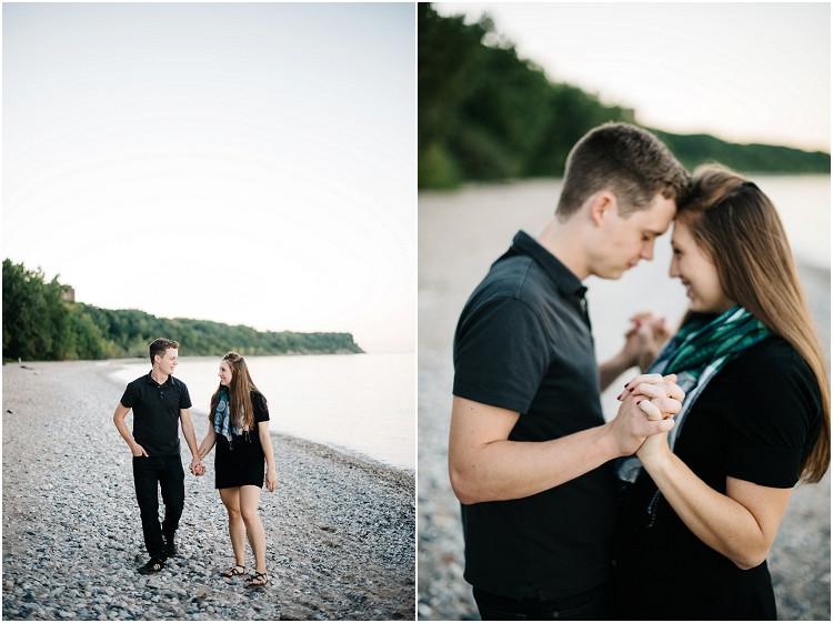 couple-walking-on-beach-at-milwaukee-lighthouse-engagement-session-by-appleton-wedding-photographer-kyra-rane-photography
