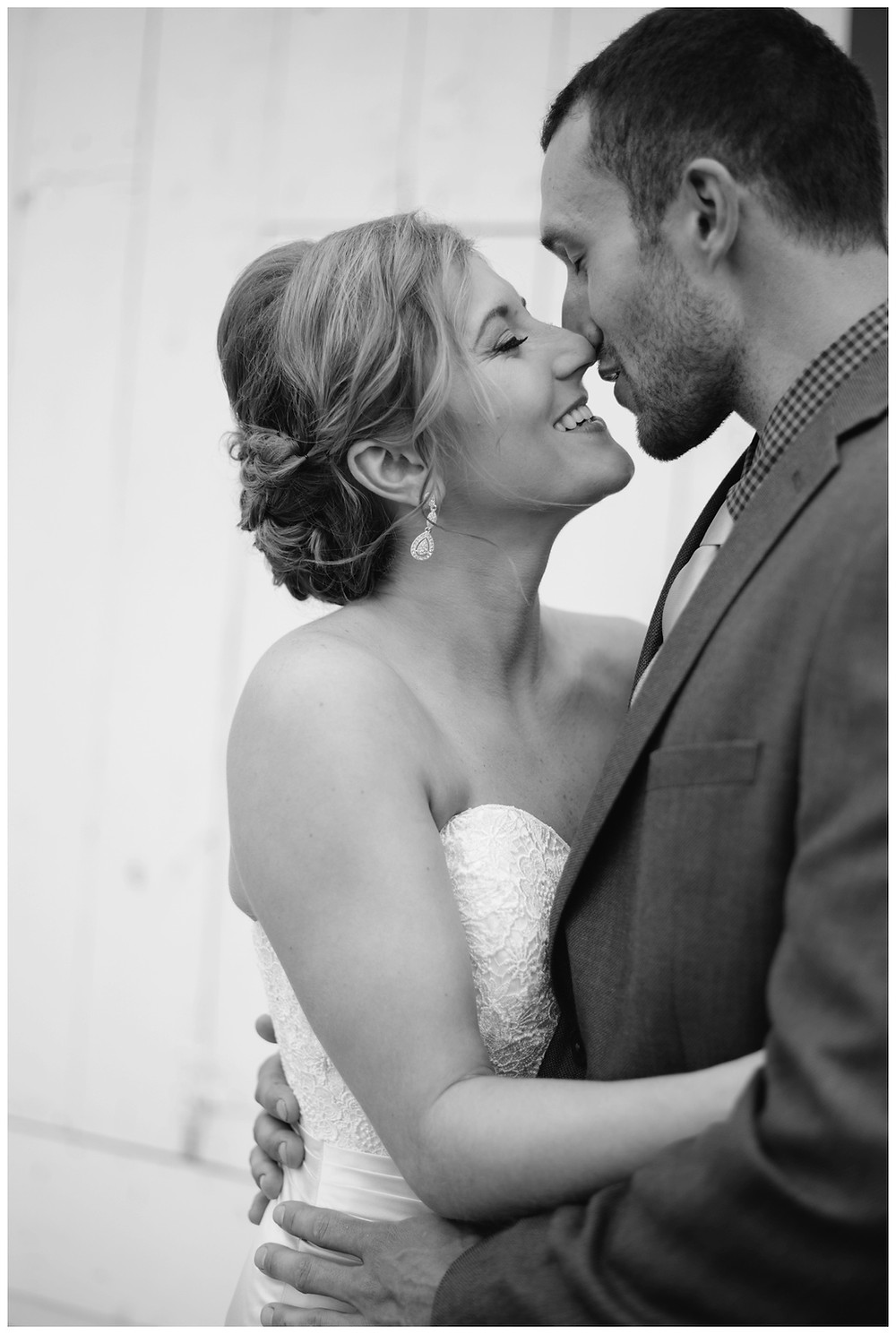 bride-and-groom-about-kiss-at-brighton-acres-wedding-by-green-bay-wedding-photographer-kyra-rane-photography
