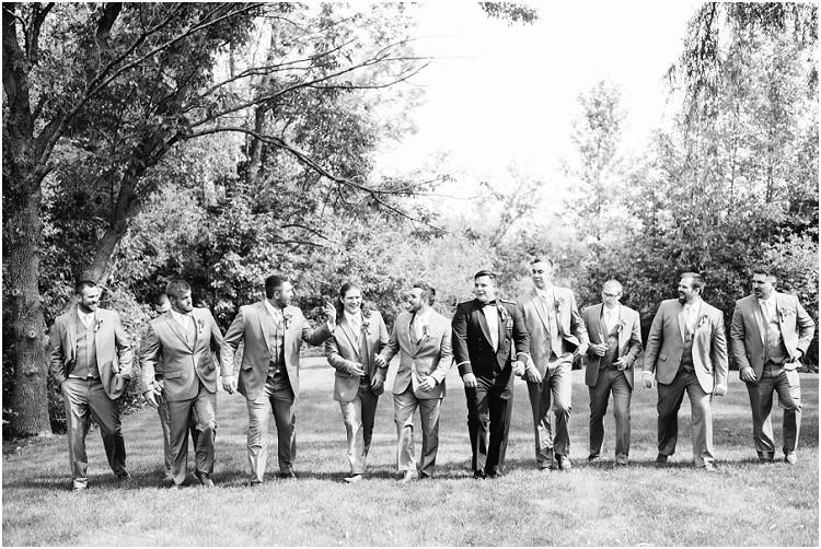 groomsmen-laughing-and-walking-at-de-pere-wisconsin-wedding-by-appleton-wedding-photographer-kyra-rane-photography