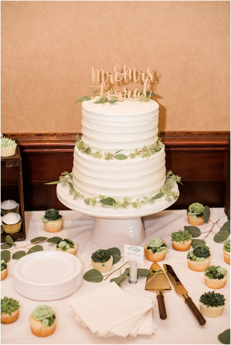 wedding-cake-with-green-florals-at-de-pere-wisconsin-wedding-by-appleton-wedding-photographer-kyra-rane-photography