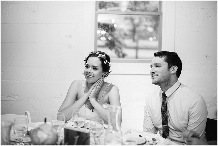 wedding-couple-sitting-at-dinner-table-at-barnsite-retreat-and-events-wedding-by-milwaukee-wedding-photographer-kyra-rane-photography