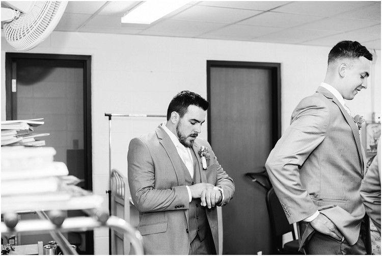 groom-checking-time-on-watch-at-de-pere-wisconsin-wedding-by-appleton-wedding-photographer-kyra-rane-photography