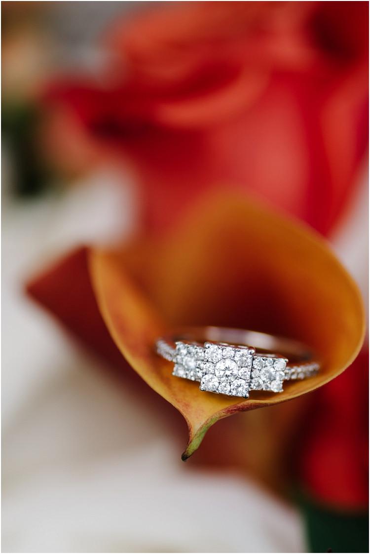 diamond-ring-in-orange-rose-at-wisconsin-farm-wedding-by-appleton-wedding-photographer-kyra-rane-photography
