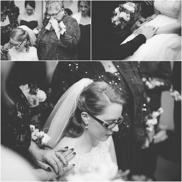 bridal-party-praying-with-bride-before-ceremony-at-sheboygan-winter-wedding-by-green-bay-wedding-photographer-kyra-rane-photography