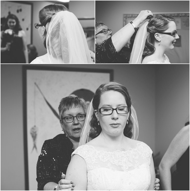 bride-putting-veil-on-at-sheboygan-winter-wedding-by-appleton-wedding-photographer-kyra-rane-photography