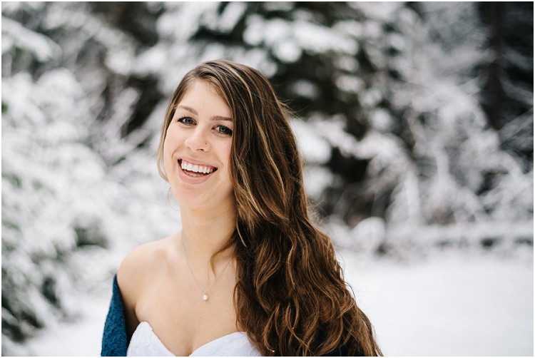 bride-laughing-in-snow-at-wisconsin-winter-bridal-portraits-by-green-bay-wedding-photographer-kyra-rane-photography