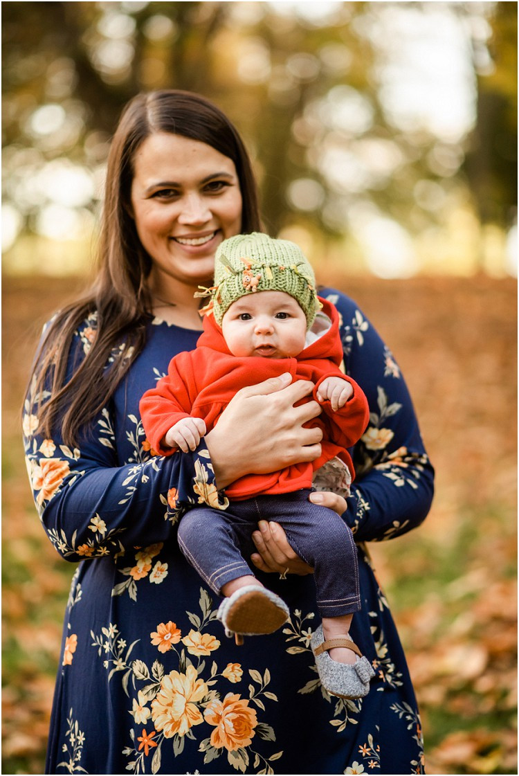 mom-holding-baby-in-green-hat-at-plamann-park-by-green-bay-wedding-photographer-kyra-rane-photgraphy