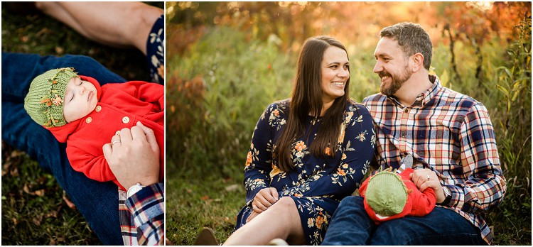 baby-in-red-coat-sleeping-on-dads-lap-at-plamann-park-by-milwaukee-wedding-photographer-kyra-rane-photgraphy