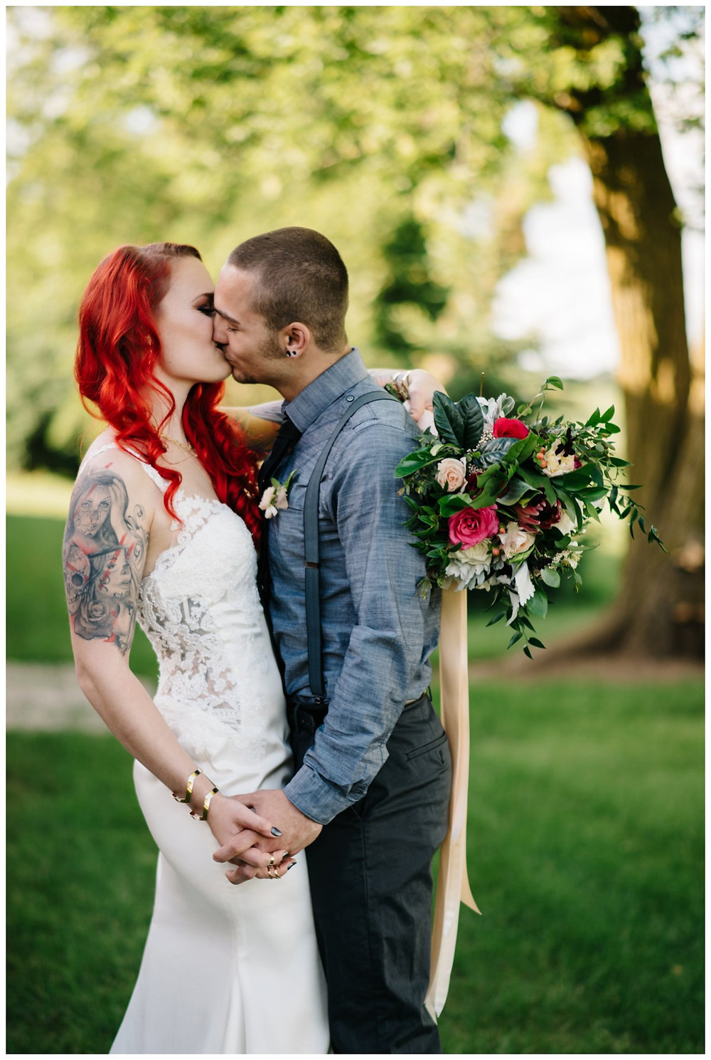 wedding-couple-holding-hands-kissing-at-homestead-meadows-styled-shoot-by-milwaukee-wedding-photographer-kyra-rane-photography