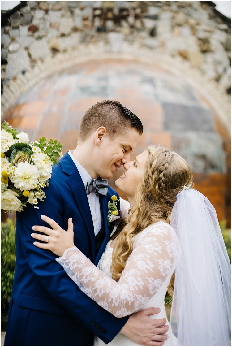 wedding-couple-holding-each-other-and-smiling-at-pamperin-park-wedding-by-green-bay-wedding-photographer-kyra-rane-photography
