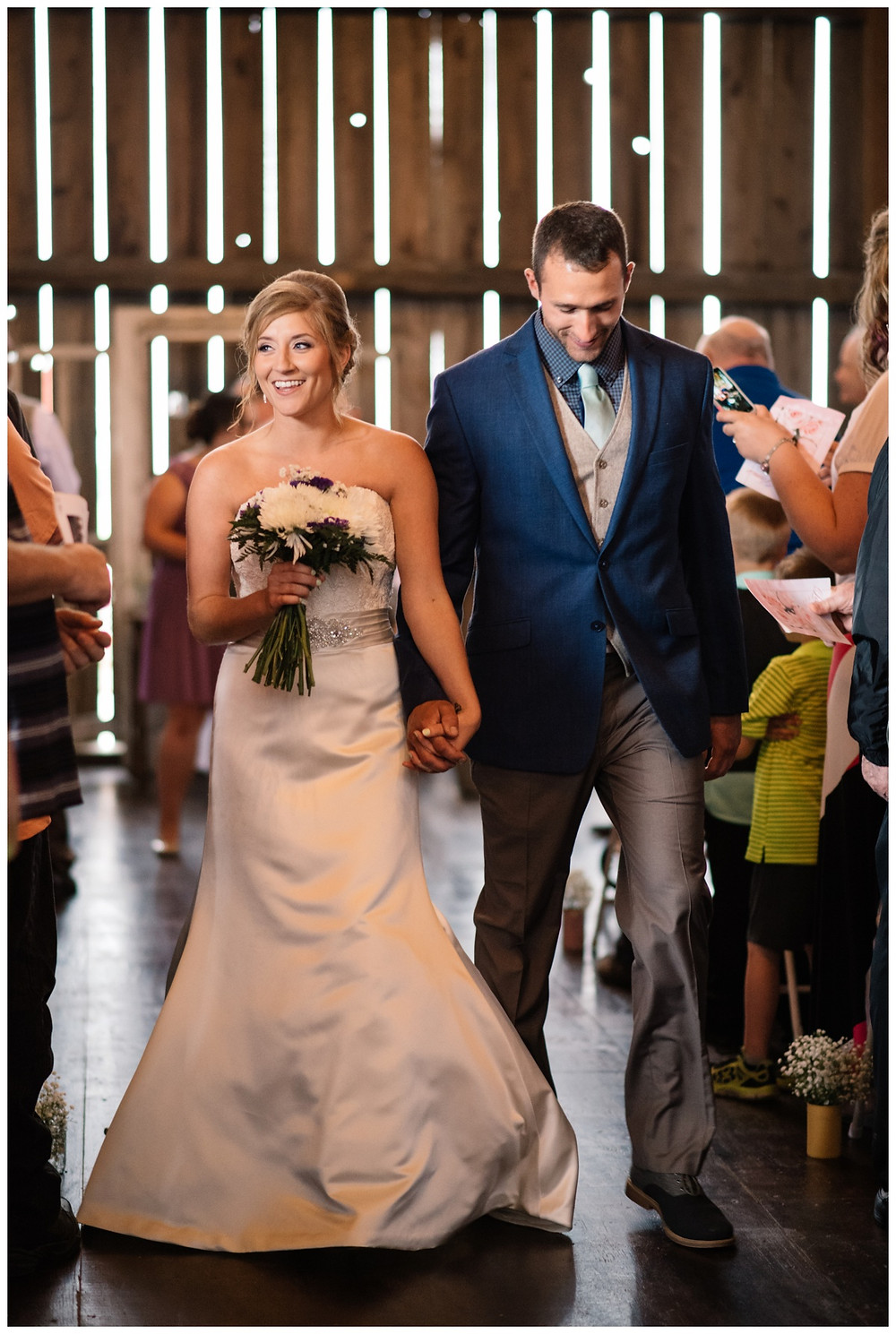 bride-and-groom-walking-down-aisle-at-brighton-acres-wedding-by-milwaukee-wedding-photographer-kyra-rane-photography