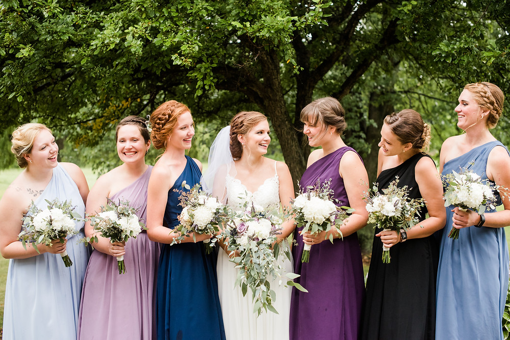 bridesmaids-smiling-at-each-other-at-how-to-be-a-dream-bridesmaid-by-appleton-wedding-photographer-kyra-rane-photography