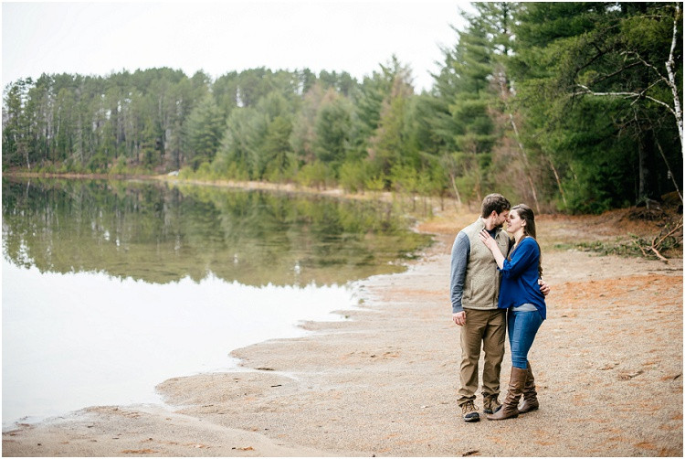 engaged-couple-about-to-kiss-by-lake-at-northwoods-lakeside-engagement-session-by-appleton-wedding-photographer-kyra-rane-photography