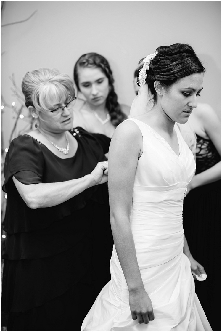 bride-putting-on-wedding-dress-at-de-pere-wedding-by-green-bay-wedding-photographer-kyra-rane-photography